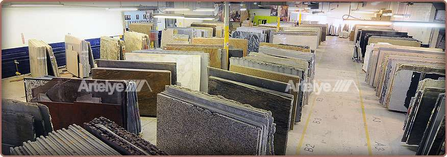 a view of all the granite slabs inside a warehouse from above